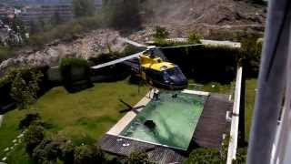 Helicopter Stealing Water from a Pool