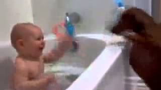 Baby Boy in Bath Tubs Plays with Dachshund Dog